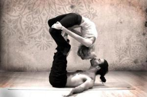 yoga couple balancing